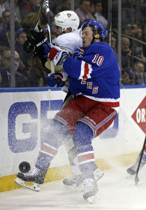 Apr 21, 2016; New York, NY, USA; New York Rangers center J.T. Miller (10) checks Pittsburgh Penguins defenseman Ian Cole (28) during the second period in game four of the first round of the 2016 Stanley Cup Playoffs at Madison Square Garden. Mandatory Credit: Adam Hunger-USA TODAY Sports