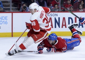 Mar 29, 2016; Montreal, Quebec, CAN; Detroit Red Wings forward Anthony Mantha (39) plays the puck and Montreal Canadiens defenseman Alexei Emelin (74) defends during the third period at the Bell Centre. Mandatory Credit: Eric Bolte-USA TODAY Sports